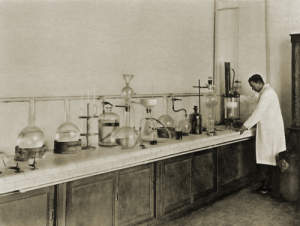 "Photographs of ""A laboratory checks the whole manufacturing process step by step."""
